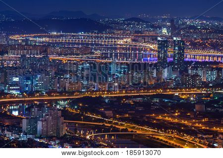 Seoul City And Bridge And Han River At Night,  South Korea.