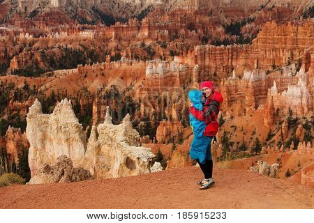 A Woman With Her Baby Boy Are Hiking In Bryce Canyon National Park, Utah, Usa