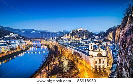 Panoramic View Of Historic City Of Salzburg With Festung Hohensalzburg And River Salzach During Blue