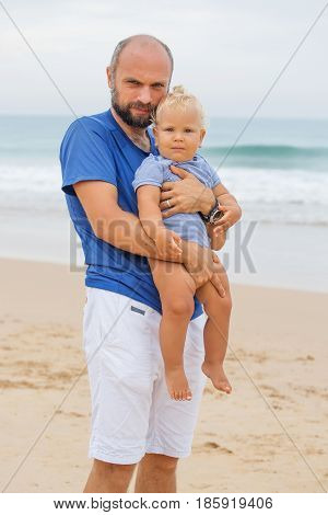 Portrait Of A Father And His Son At The Seashore