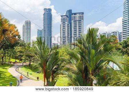 KUALA LUMPUR MALAYSIA - AUGUST 3: KLCC park with Kuala Lumprur skyline in the background on August 3 2016 in Kuala Lumpur Malaysia.