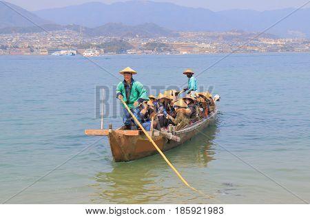 HIROSHIMA JAPAN - MARCH 19, 2017: Unidentified people take a Itsukushima shrine cruise boat in Miyajima. Miyajima is famous for Itsukushima shrine.