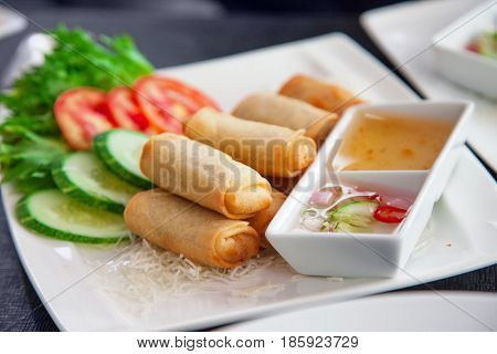 Traditional Thai cuisine dish on white square plate and black background