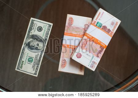 Russian Ruble and and US Dollars on wooden background