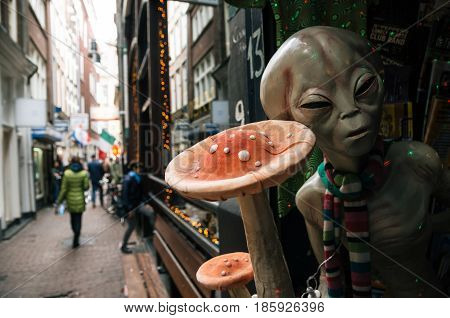 Amsterdam Netherlands - 26 April 2017: Shape of the drugged alien beckoning tourists magic mushrooms in a Smart Shop in Amsterdam city center.