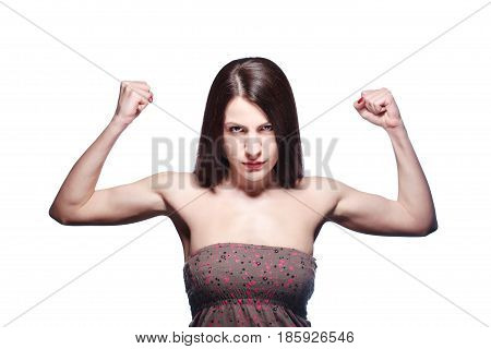 brunette girl showing her muscles, isolated on white