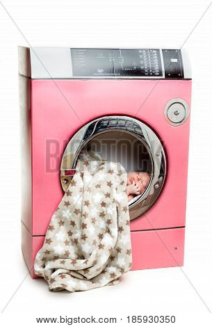 Portrait of an infant baby in a washing machine