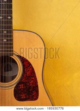 Acoustic guitar on background of old wall