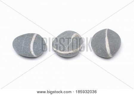 Three striped gray stones isolated Three striped gray stones isolated