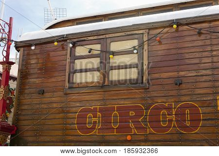Circus wooden vintage caravan with painted spanish circo lettering