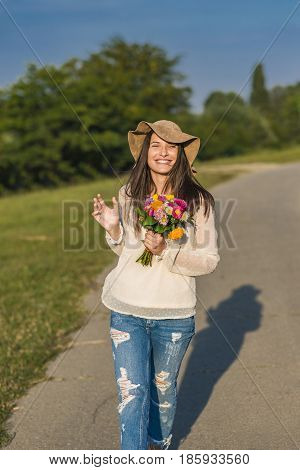 Young Woman Walking Cheerful And Relaxed By The River