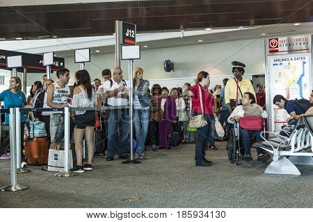 LOS ANGELES USA - AUG 312014: special wheel chair assistance helps handicapped people to avoid long queues. The procedure is strictly regulated due to security reasons.