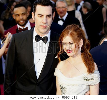 Sacha Baron Cohen and Isla Fisher at the 88th Annual Academy Awards held at the Hollywood & Highland Center in Hollywood, USA on February 28, 2016.
