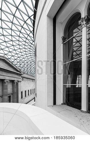 London United Kingdom - June 14 2006: Interior of the Great Court surrounding the original Reading Room at the British Museum designed by architect Lord Norman Foster. Black and white.