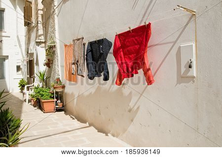 Perspective of alleyway of Monopoli. Puglia. Southern Italy.