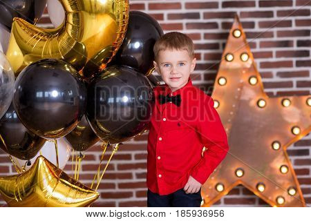 Beautiful kids, little boys celebrating birthday and blowing candles on homemade baked cake, indoor Birthday party for siblings children. Happy twins about gifts and frirework