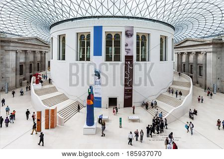 London United Kingdom - June 14 2006: Tourists in the Great Court surrounding the original Reading Room at the British Museum designed by architect Lord Norman Foster