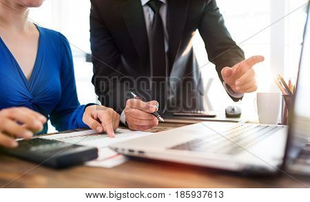 Businessman And Businesswoman Are Working In Office Together In Cooperation