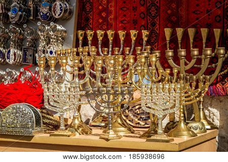 JERUSALEM, ISRAEL - OCTOBER 3: The menorah, traditional jewish candlestick and souvenirs in gift shop on Arab market in Old City of Jerusalem, Israel on October 3, 2016