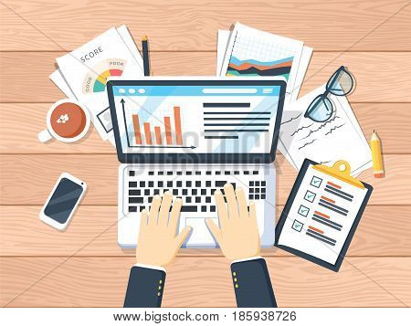 Businessman working on laptop. Hands on laptop and computer mouse documents forms notebook coffee notes pen. Work place analytics optimization management. Top view wooden office work desk