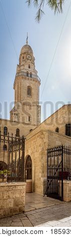 The clock bell tower of the Dormition Abbey, outside the walls of the Old City of Jerusalem, Israel