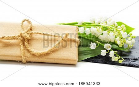 Lily of the Valley on a slate with a gift