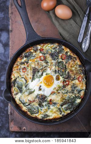 egg frittata with potatoes, nettles and pepper