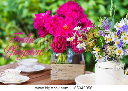 flowers and coffee cups to Pentecost on the terrace