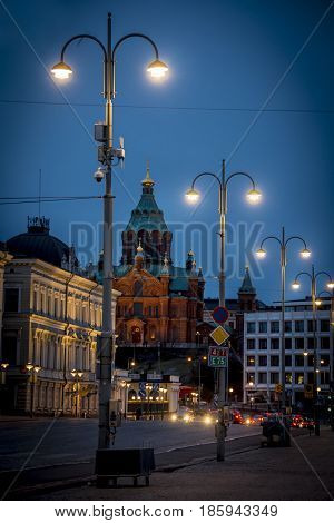 Night descends on Helsinki street with Uspenski Cathedral in background