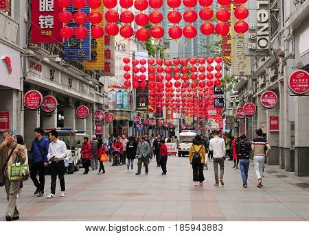March 14 2017. Guangzhou China. Chinese tourists on Shang Xia Jiu Pedestrian Street in the Xiguan district in the city of Guangzhou China on an overcast day in Guangdong province.
