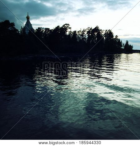 Ladoga lake. Late evening. Saint Nicholas's church on the island (skete). Valaam island. Aged photo. Beautiful churches. Nikolsky monastery. Nicholas The Wonderworker church. Karelia Russia.