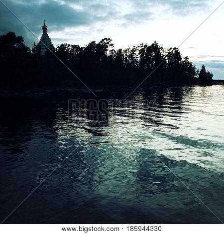 Ladoga lake. Late evening. Saint Nicholas's church on the island (skete). Valaam island. Aged photo. Beautiful churches. Nikolsky monastery. Nicholas The Wonderworker church. Karelia Russia.