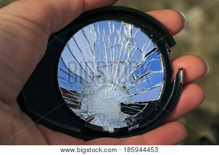 beauty of the broken mirror in the small cracks in the hand