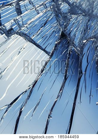 shiny texture blue mirror surface with small and large cracks