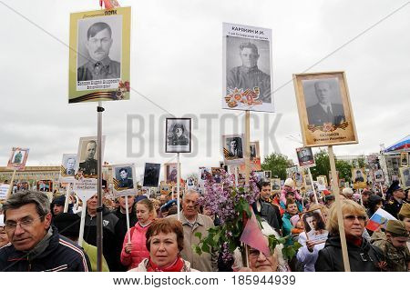 Orel Russia - May 9 2017: Victory Day selebration. Big crowd of people marching in Immortal regiment with portraits of their war hero relatives in hands