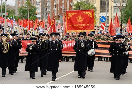 Orel Russia - May 9 2017: Victory Day selebration. Military orchestra marching in front of Immortal regiment horizontal