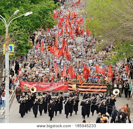 Orel Russia - May 9 2017: Victory Day selebration. Large crowd of people and military orchestra marching in Immortal regiment viewed from the height