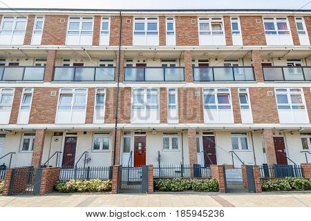Facade of council housing flats in Brownfield East London