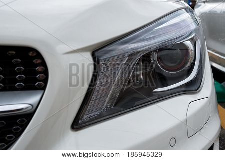 Closeup of new LED projector headlight on the modern car.