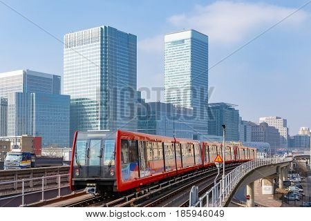 Docklands light railway in London with Canary Wharf in the background
