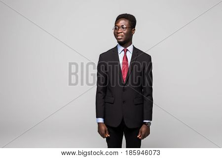 Handsome African Man Looking Away While Standing Against Grey Background
