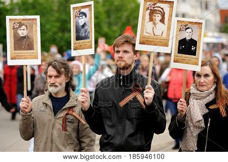 Orel Russia - May 9 2017: Victory Day selebration. People holding portraits of their hero ancestors in Immortal regiment march horizontal