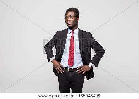 Handsome Young African Man In Suit While Standing Against Grey Background
