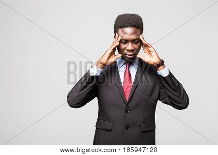 Frustrated Young African Man Holding Fingers On Head And Looking At Camera While Standing Against Gr