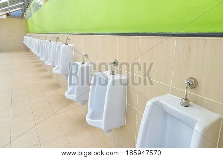 New row of outdoor urinals men public toilet