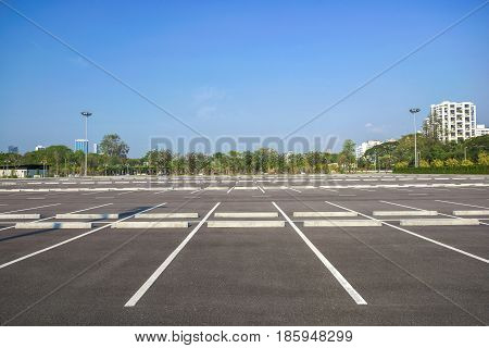 Empty parking lot at city center with blue sky