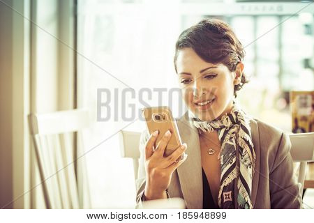 Beautiful middle eastern woman text messaging