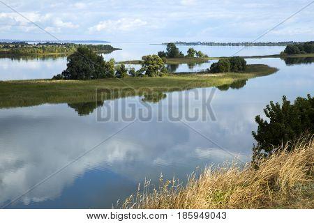 Beautiful landscape of coast and islands on Volga river and a boat, Tatarstan, Russia
