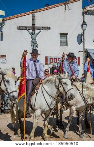 Sent-Mari-de-la-Mer, Provence, France - May 25, 2015. Convoy - guards on white horses before the start of the parade. World Festival of Gypsies
