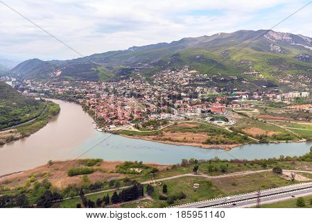 Panoramic aerial view of Mtskheta, Georgia with rivers Mtkvari or Kura and Aragvi, Svetitskhoveli Cathedral